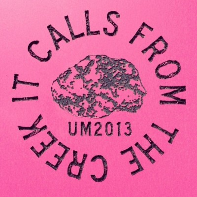 "Unmanned Minerals, ""It Calls from the Creek"" milled badge"